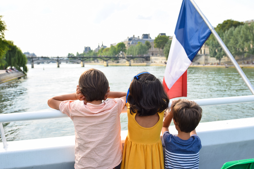 Best Things to Do In Paris With Kids featured by top US family travel blog, Local Passport Family: image of bateaux-mouches best things to do in paris with kids