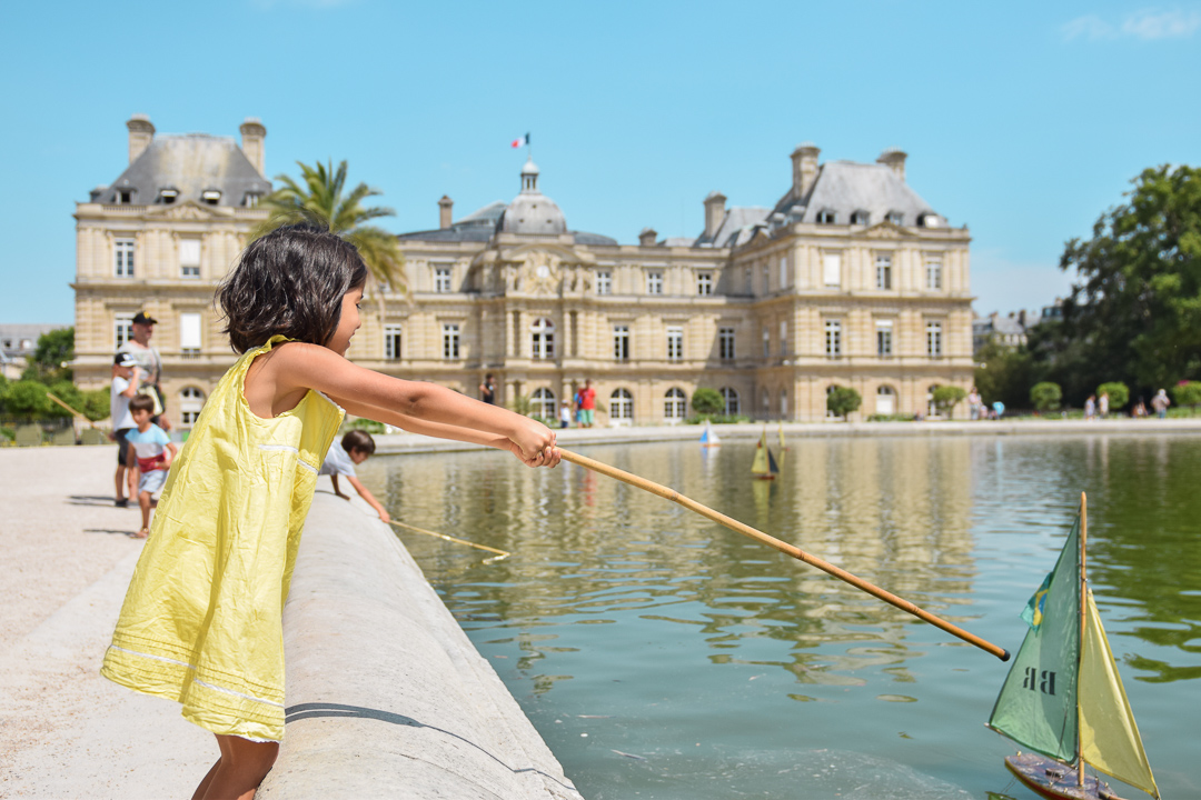 Best Things to Do In Paris With Kids featured by top US family travel blog, Local Passport Family: image of luxembourg gardens best things to do in paris with kids
