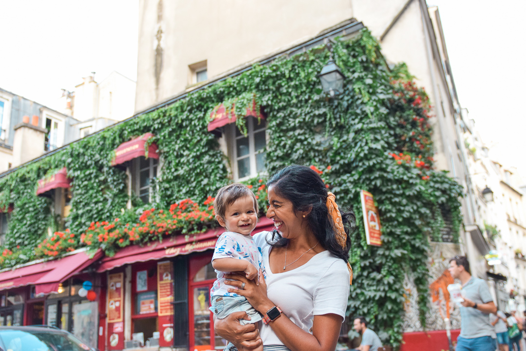 Best Things to Do In Paris With Kids featured by top US family travel blog, Local Passport Family: image of the marais district with baby