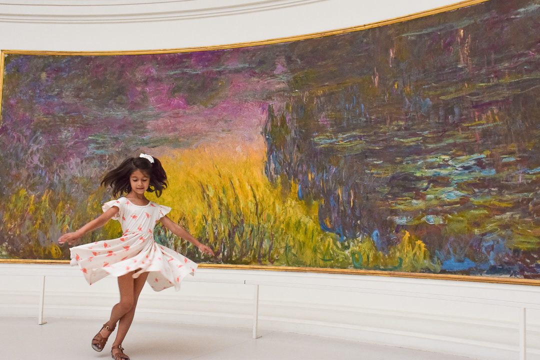 Best Things to Do In Paris With Kids featured by top US family travel blog, Local Passport Family: image of orangerie museum with kids paris