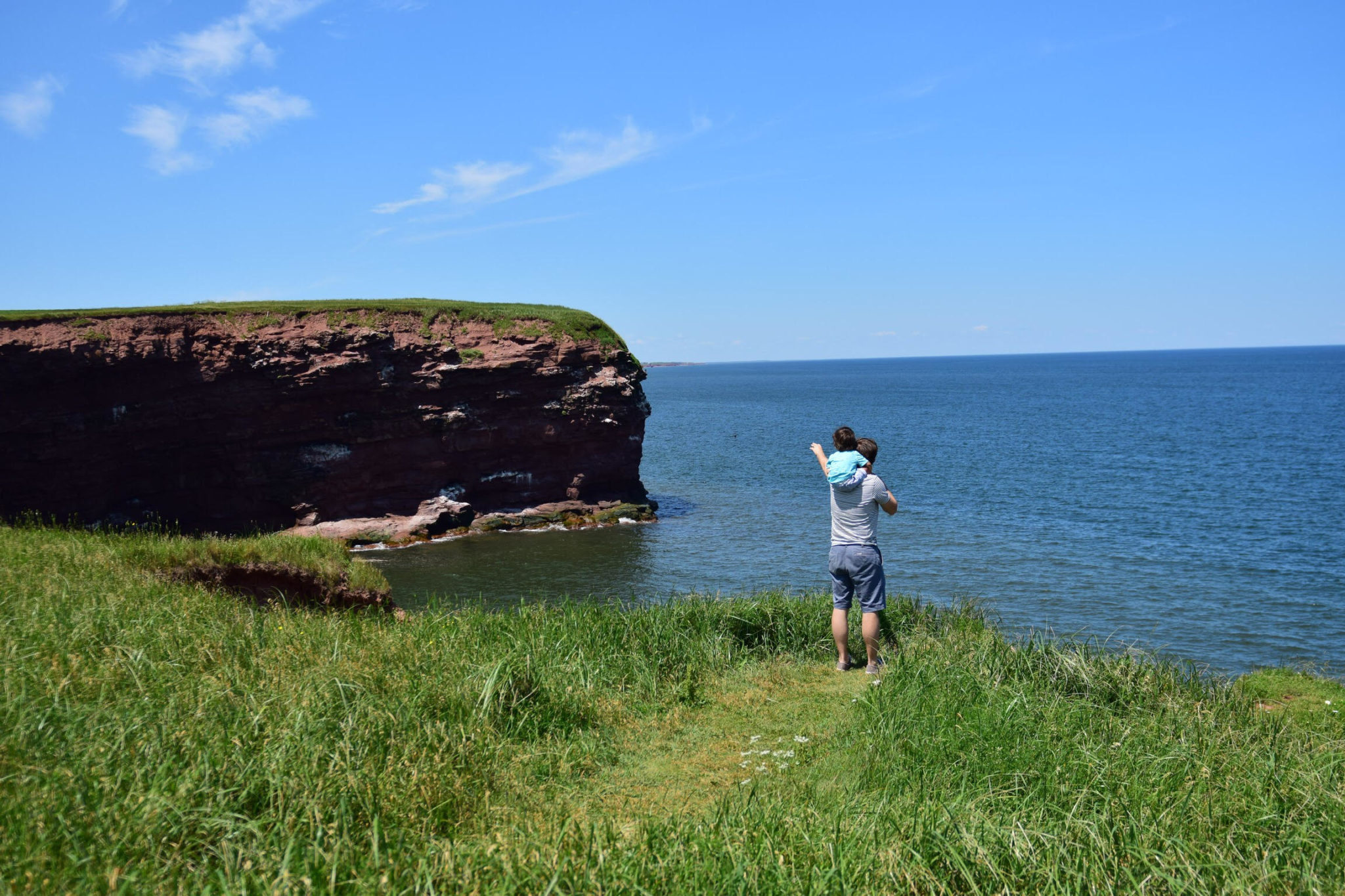 Ultimate Guide to Prince Edward Island with Kids, featured by top US family travel blog, Local Passport Family | prince edward island cliffs lighthouse