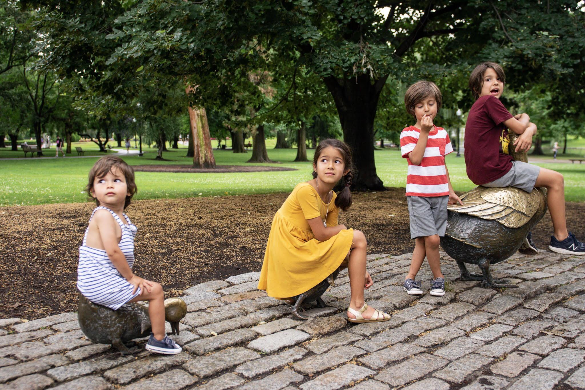 kids in boston duck statues