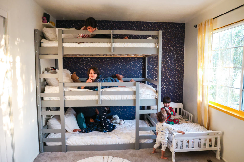 four kids sleeping in a room